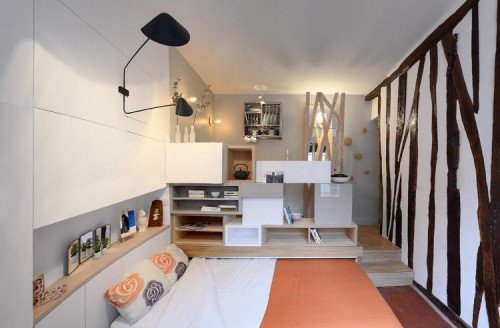 A modern clean bedroom inside a 129-square-foot Parisian apartment.