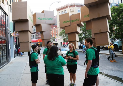 MakeSpace street team in NYC carrying boxpacks.