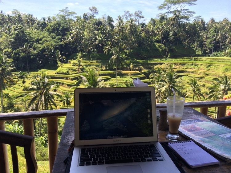 Tyler Tringas' workstation on a balcony overlooking a rice terrace.