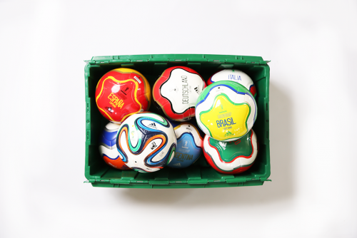A MakeSpace storage bin full of 2014 FIFA World Cup soccer balls from the Adidas store in SoHo Manhattan
