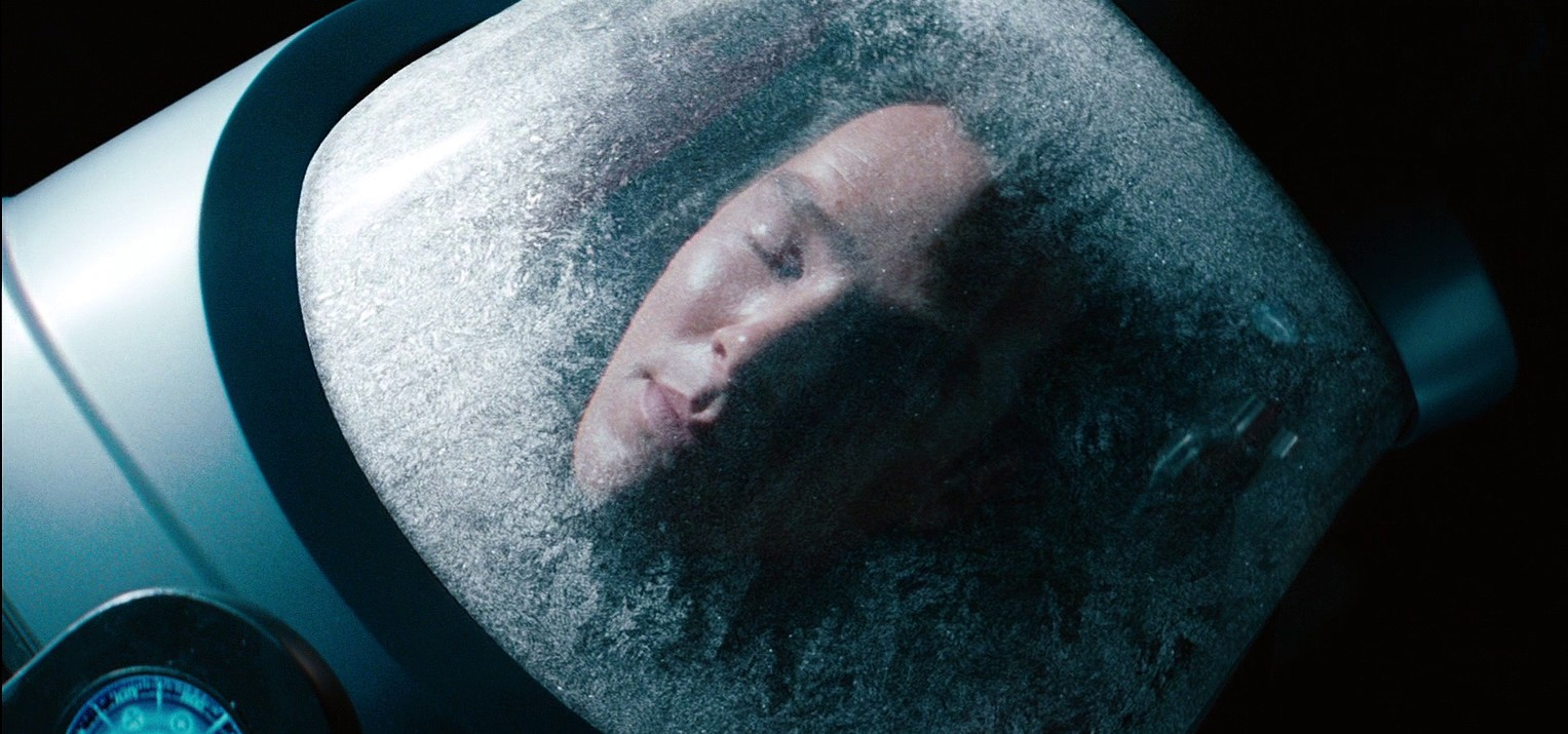 A man is hibernating in a cryo chamber, the ultimate air conditioner.