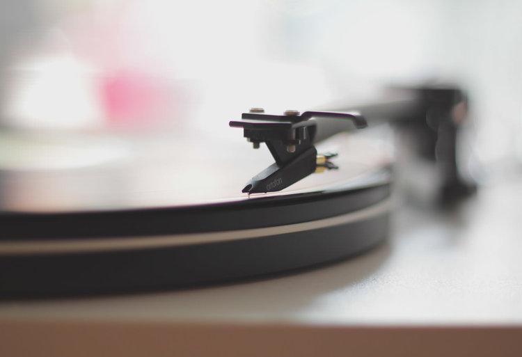 A closeup of a vinyl record player.