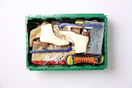 The green MakeSpace storage bin of Emmy-award winning food and travel journalist Michael-Ann Rowe stores her ice skates, jackets, and snow boots.