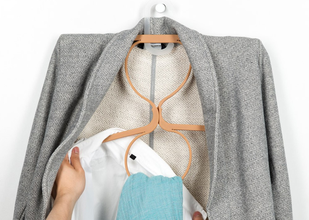 Ivan Zhang's elastic Hanger turns into 2 hangers with 2 loops for more clothes storage.
