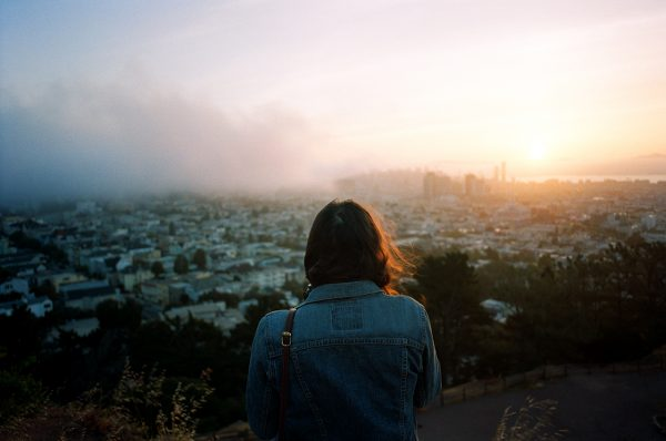 photo taken by ike edeani of a woman overlooking a city