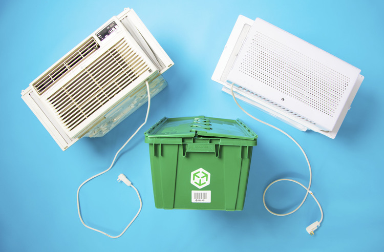 A MakeSpace storage bin is surrounded by two window air conditioners.