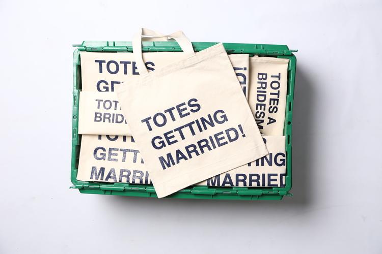 "The green MakeSpace storage bin of Brooklyn-based event and wedding planner Jove Meyers contains decorations, supplies, and ""Totes Getting Married!"" tote bags."