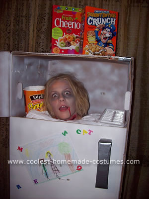 A girl wearing a scary frozen head in fridge Halloween costume.