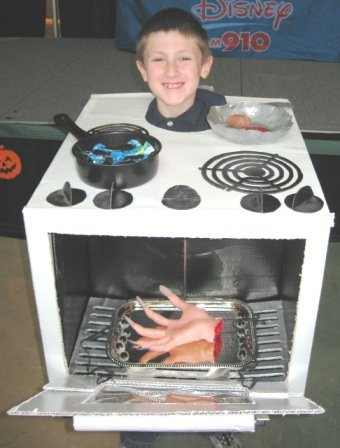 A boy is wearing an oven Halloween costume.