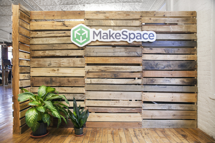 The DIY wood pallet wall in the entrance of MakeSpace's NYC headquarters.