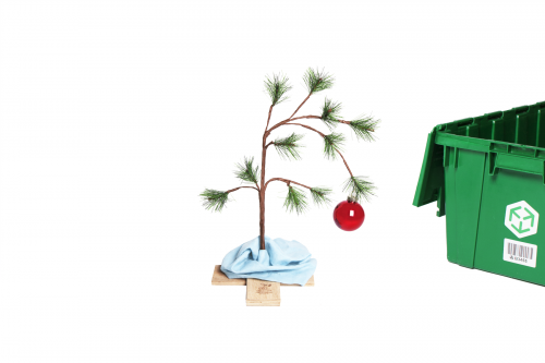 A 24-inch Charlie Brown Christmas Tree and a MakeSpace storage bin on the side.