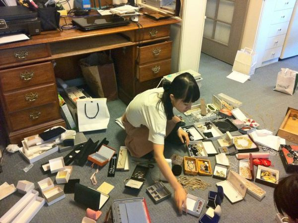 marie kondo tidying up and sorting items into categories
