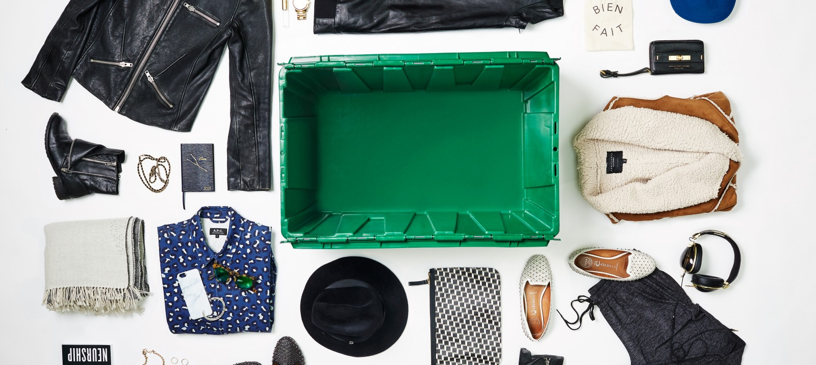 A MakeSpace storage bin surrounded by designer shoes, bags, watches, hats, boots, pants, jackets, bracelets, scarves, necklaces, and headphones.