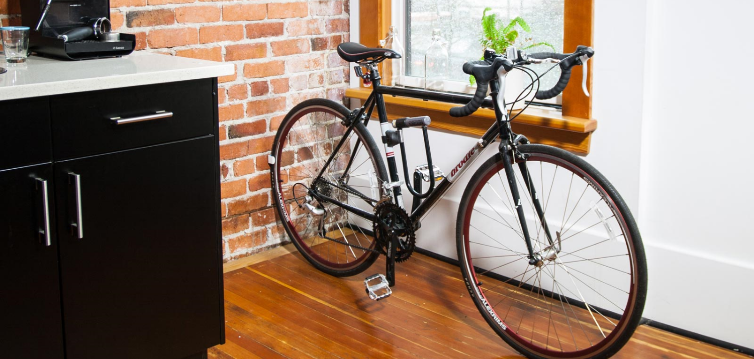 CLUG bike storage rack is storing a black bike inside a tiny kitchen. & CLUG: The Perfect Bike Storage Rack For Your Tiny Apartment