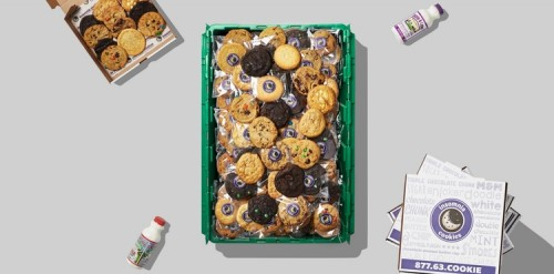 A green MakeSpace storage bin is full of Insomnia Cookies from NYC.