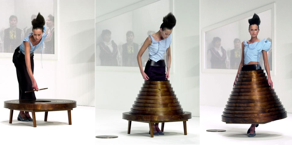 Fashion Designer Hussein Chalayan created a modern coffee table with storage skirt.