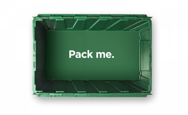 "An empty MakeSpace storage bin that reads ""Pack me."""