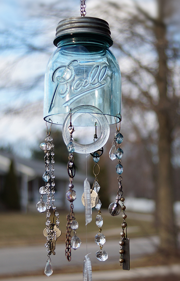 Hear relaxing sounds on the balcony of your tiny apartment by making DIY mason jar wind chimes.