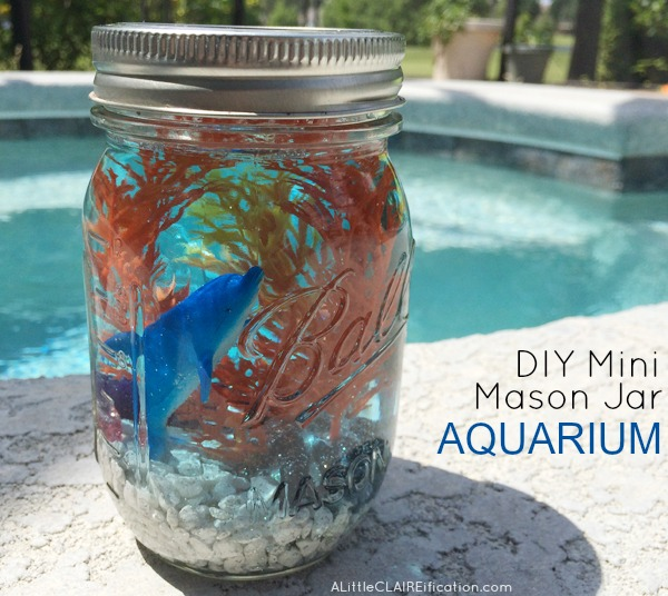 A DIY mason jar aquarium brings sea life into a kids bedroom in a tiny apartment.