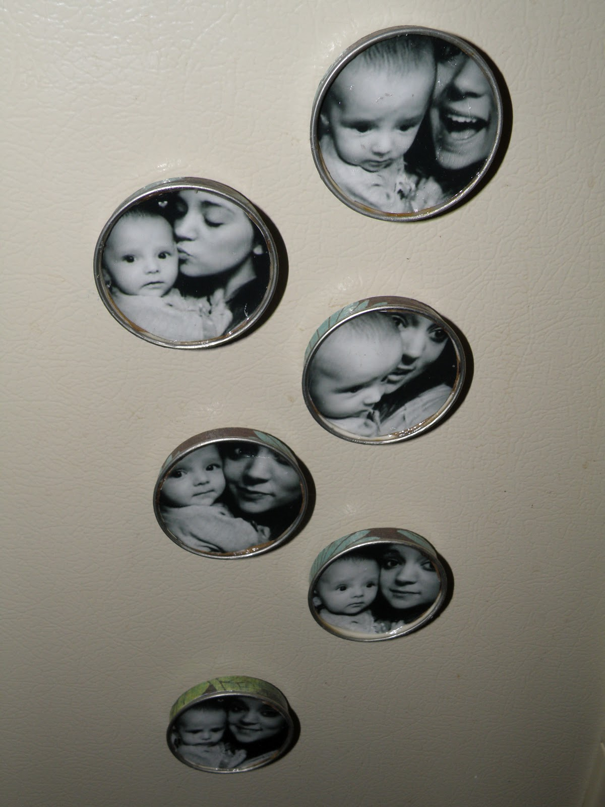Cheap photo storage in a tiny apartment is easy with a DIY mason jar picture magnet.