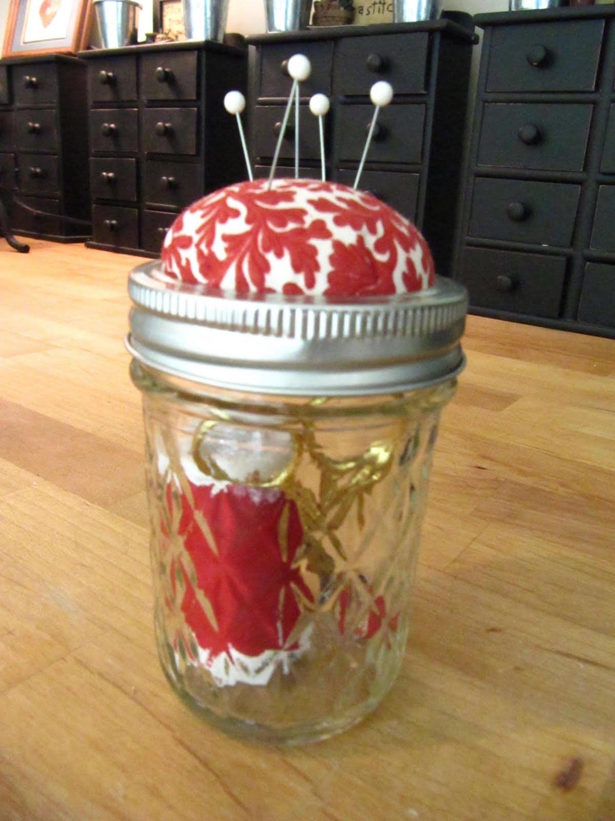 A DIY mason jar is the perfect sewing supplies storage that also saves space in a small apartment.