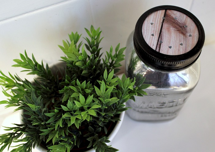A DIY mason jar air freshener makes the bathroom inside your tiny apartment smell nice.