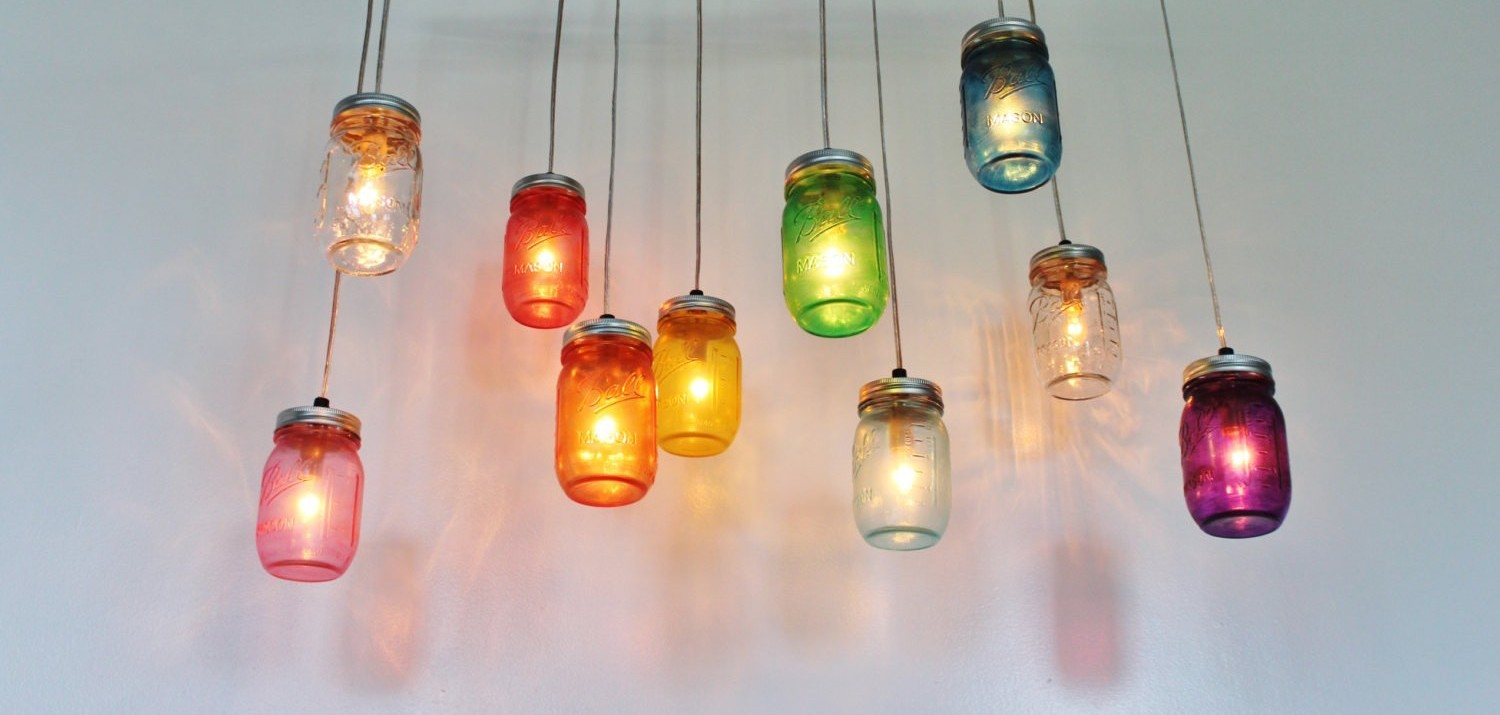 10 brilliant mason jar diy ideas for your tiny apartment this genius diy mason jar chandelier shines a rainbow in your tiny apartment arubaitofo Image collections
