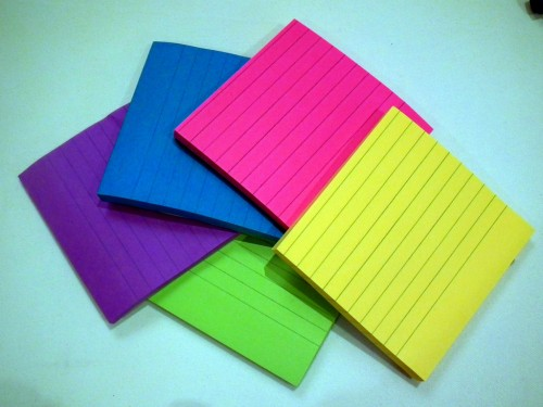 An easy packing tip is using multi color sticky notes to color code your stuff according to room.