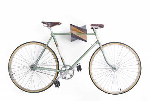 The wooden Iceberg Chestnut is an X-shaped bike storage rack that doubles as fine art.