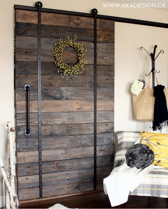 A DIY wooden shipping pallet door used for privacy in tiny apartment rooms.