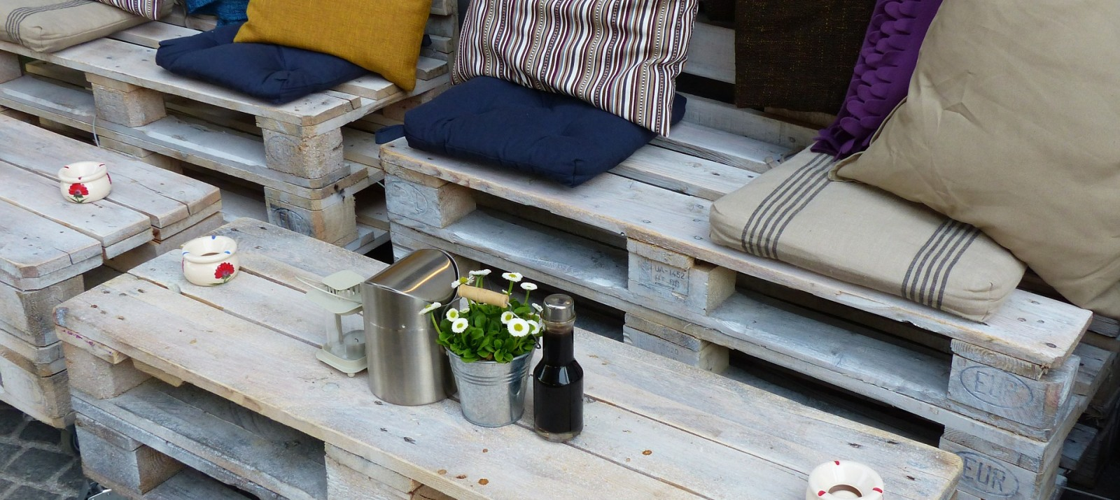 diy wood pallet patio furniture with colorful cushions and storage