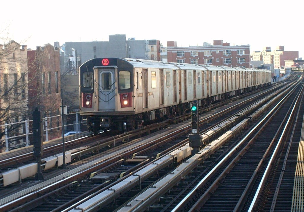 The 2 train entering the east 174th street station in the Bronx, Manhattan NYC.