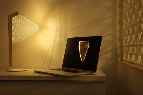 Studio Cheha's 2D/3D DESKi BULBING lamp is on a desk with storage and illuminating a laptop.