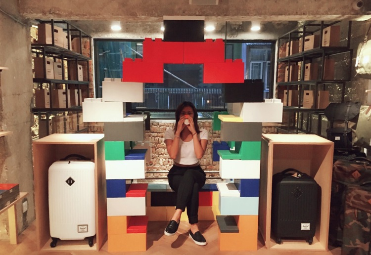 A woman sitting in giant LEGO furniture made of EverBlocks.