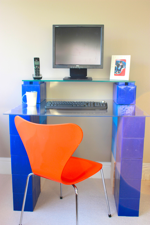 A blue giant LEGO desk built out of EverBlocks.