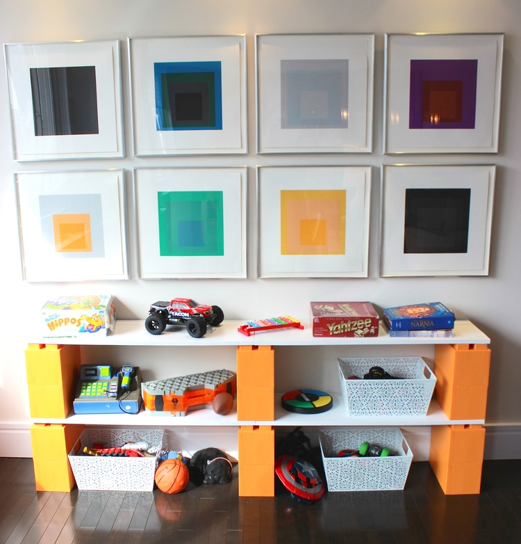 These orange EverBlocks, which look like big LEGOs, make cheap shelves with toy storage.