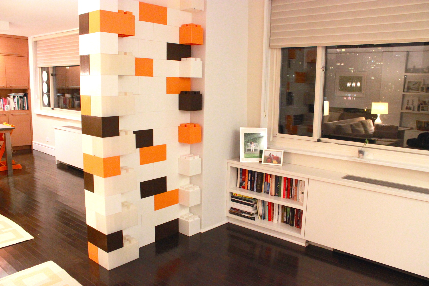 An accent wall made of brown, orange, and white EverBlocks, which look like big LEGO bricks.