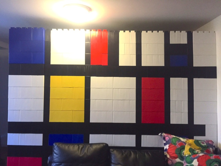 A Piet Mondrian wall made of white, black, blue, red, and yellow EverBlocks.