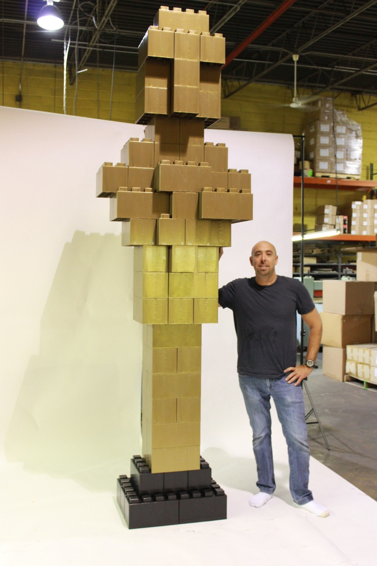 A giant gold Oscar award built with EverBlocks that look like big LEGOs.