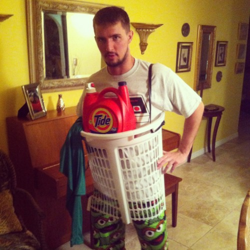A man wearing a laundry basket DIY Halloween costume.