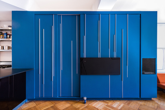 The closed blue space-saving furniture/storage cabinet in the Unfolding Apartment that's located in Manhattan, New York.