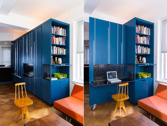The office/library inside of the blue multipurpose furniture/storage cabinet in Unfolding Apartment, a tiny apartment that's located in Manhattan NYC.