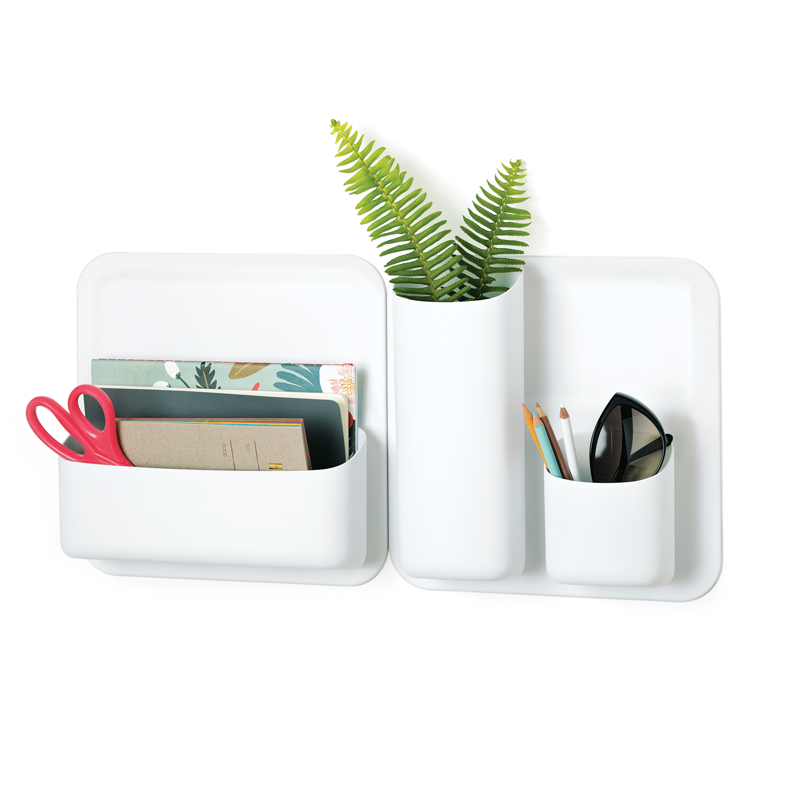 White Urbio storage containers are organizing office supplies, sunglasses, and a small plant.
