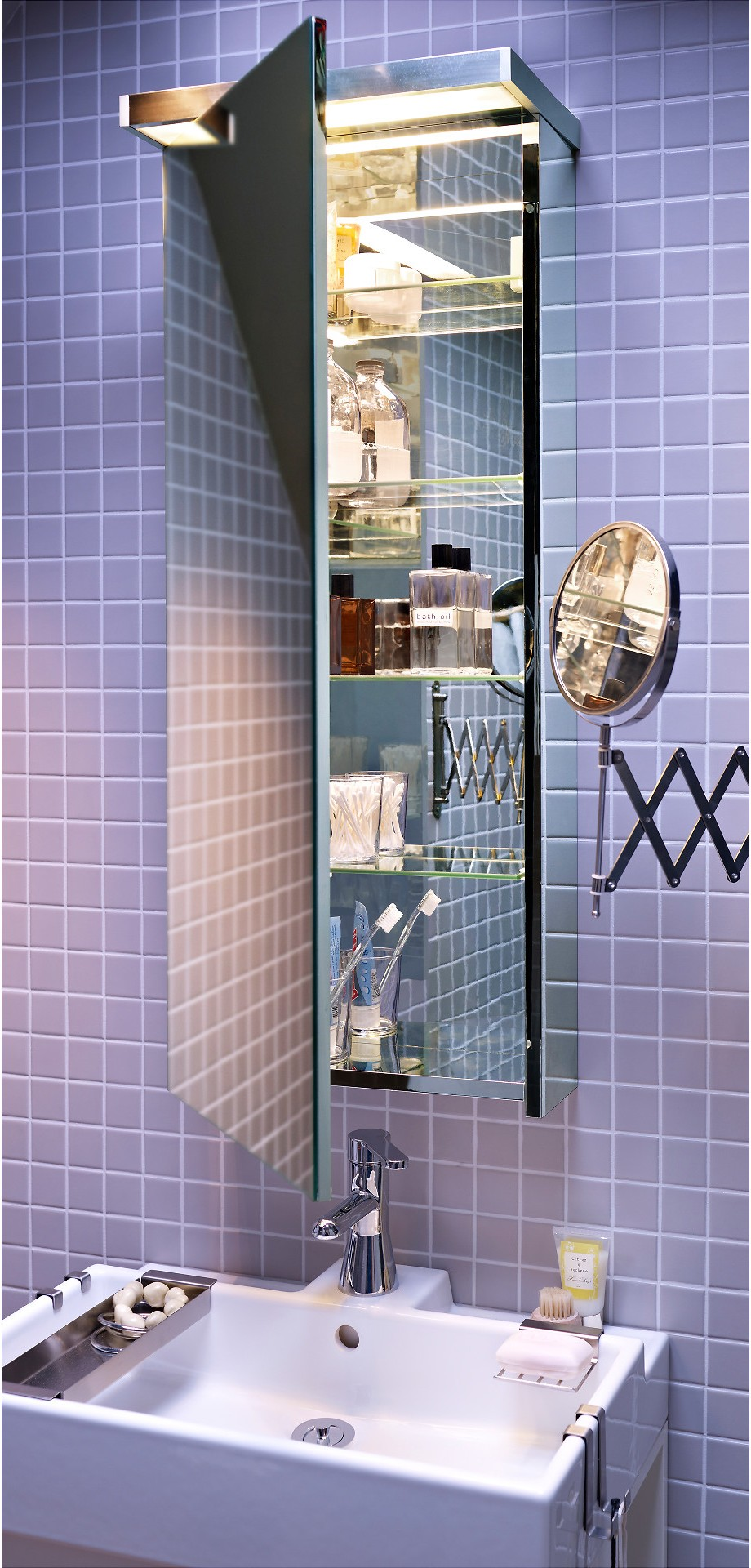 An IKEA GODMORGON, which is a big storage cabinet with four adjustable shelves and a dual-side mirror, is mounted to a tiled bathroom wall.