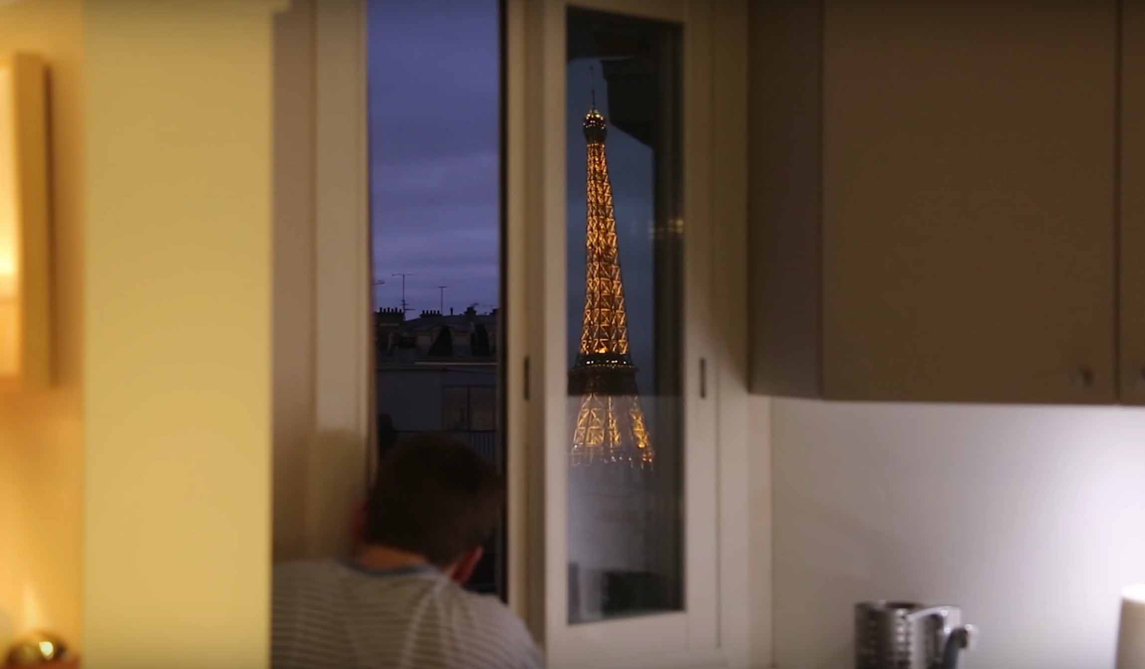 A nighttime view of the Eiffel Tower from a bedroom window in Paris, France thanks to French Redditor Lurluberlu's giant periscope.