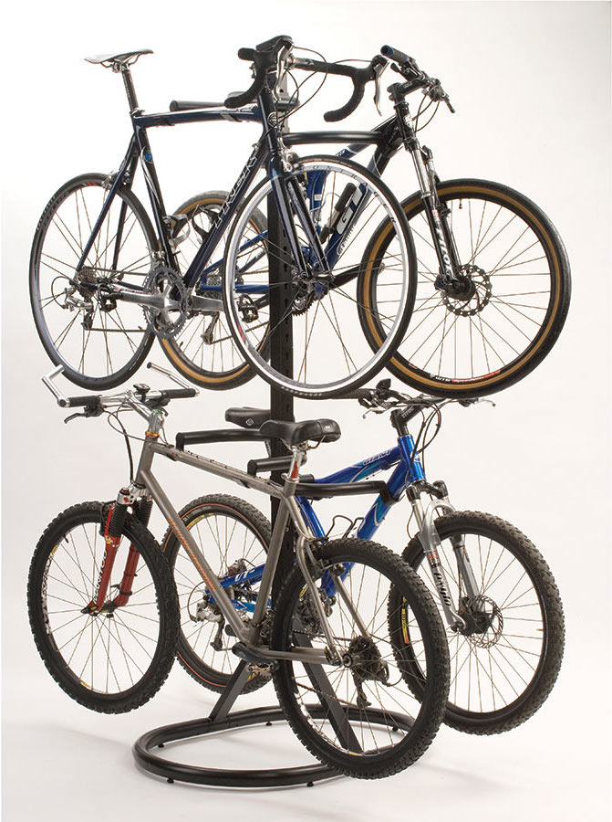 A Quad Bike Storage Rack From Brookstone Stores Four Bikes Vertically In A  Small Apartment.