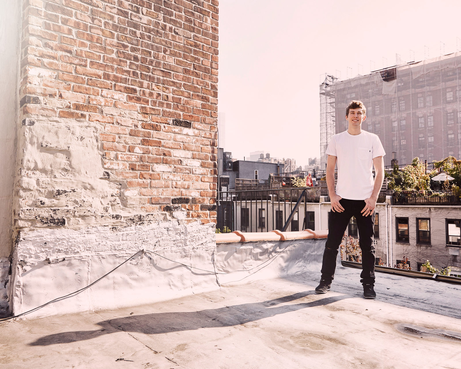 Grayson Altenberg stands on the roof of his 100-square-foot apartment on the Upper West Side of Manhattan.