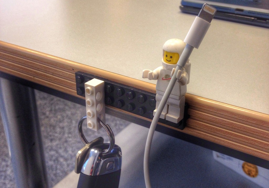 diy keys and cable holder made from sugru and a lego plate, brick, and man