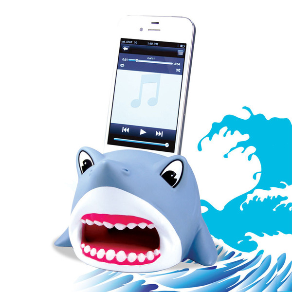 A Shark Powerless Amplifier from DCI Gift is storing a white iPhone 6.