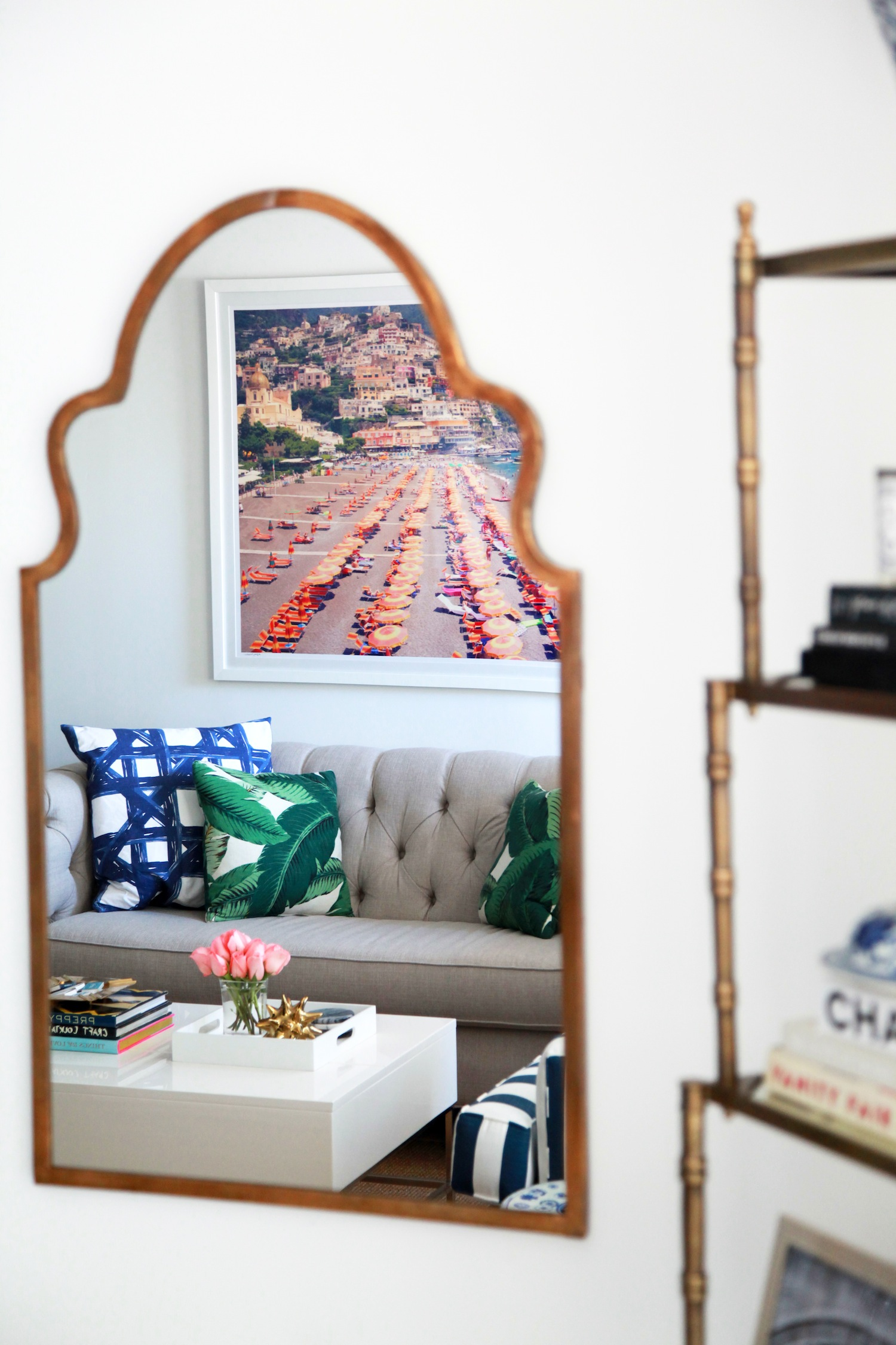 A creative decorating idea to make an apartment feel bigger is to strategically hang mirrors on a wall.